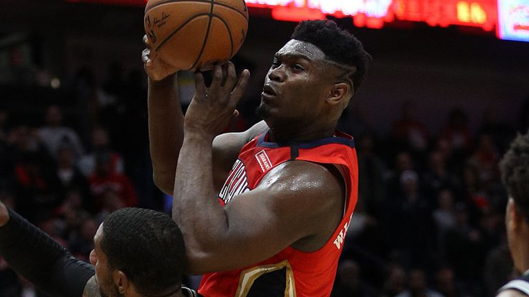 Zion Williamson fires a shot up during his debut