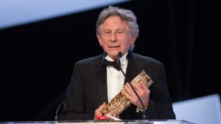 Roman Polanski receives the Best Director award for 'Venus in Fur' on stage during the 39th Cesar Film Awards 2014