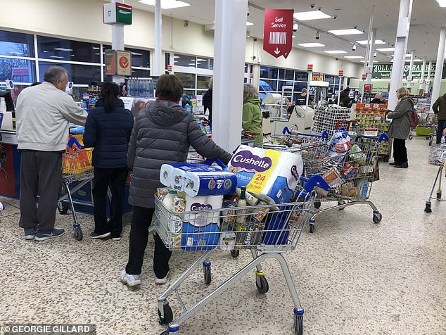 Ms Green said there were lots of substitutes in her shopping. People are pictured above getting shopping from a Tesco store