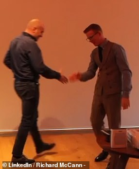 Richard McCann is seen above miming a handshake with an attendee at his event in Leeds