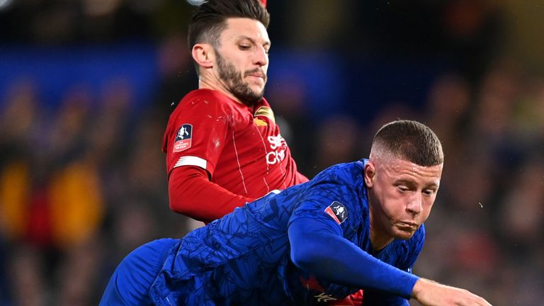 Ross Barkley is challenged by Adam Lallana